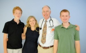 (Dr.William Selvidge beside his wife, Jennifer and sons, Shafe (far left) and Lucas (far right).